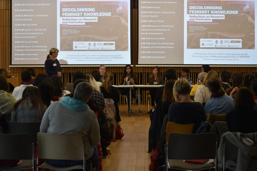 A panel speaks to an audience at the Decolonizing Feminist Knowledge conference.