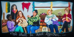 Painting of a group of women knitting, with the phrase 'We shall be knit together' underneath.